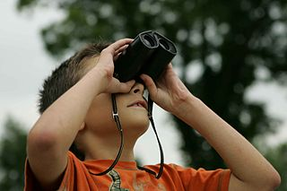 boy with a pair of compact binoculars