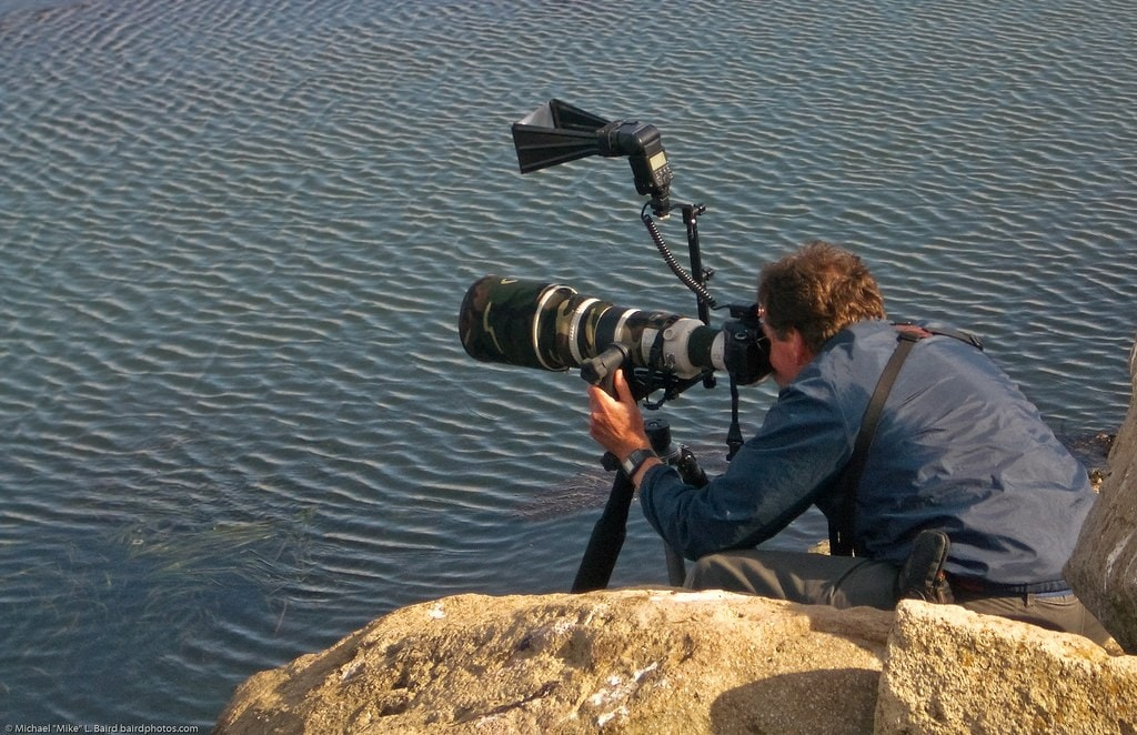 """<img src=""""telephotolens.jpg"""" alt=""""a man using a telephoto lens with his camera"""">"""
