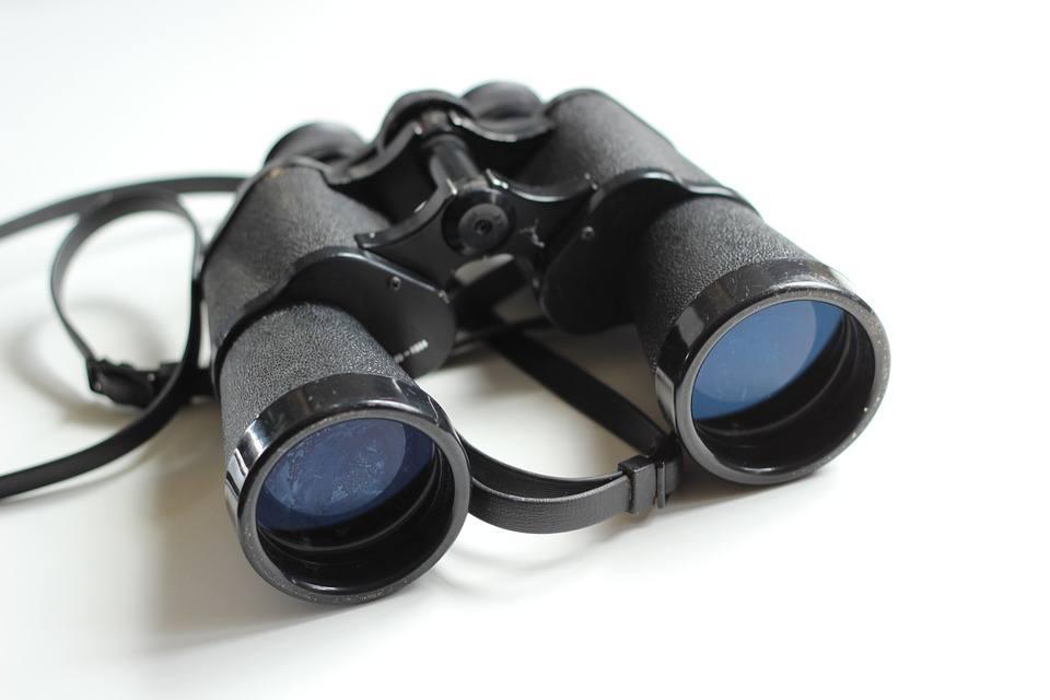 "<img src=""binoculars.jpg"" alt=""binoculars on a white surface"">"