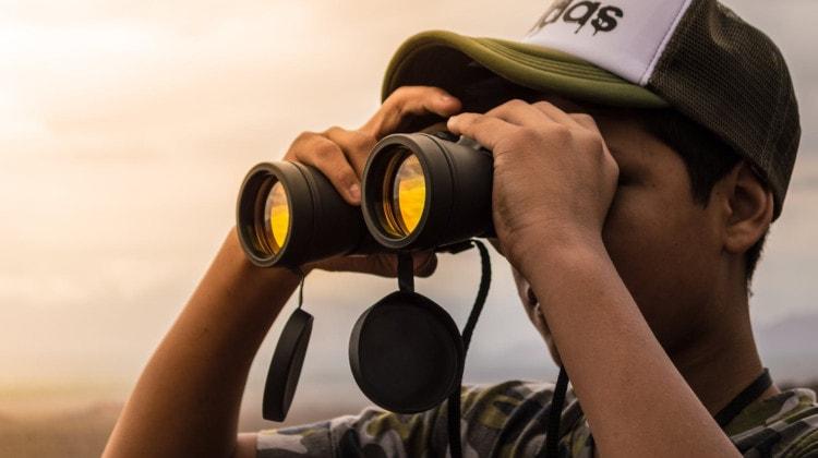 how to hold binoculars steady