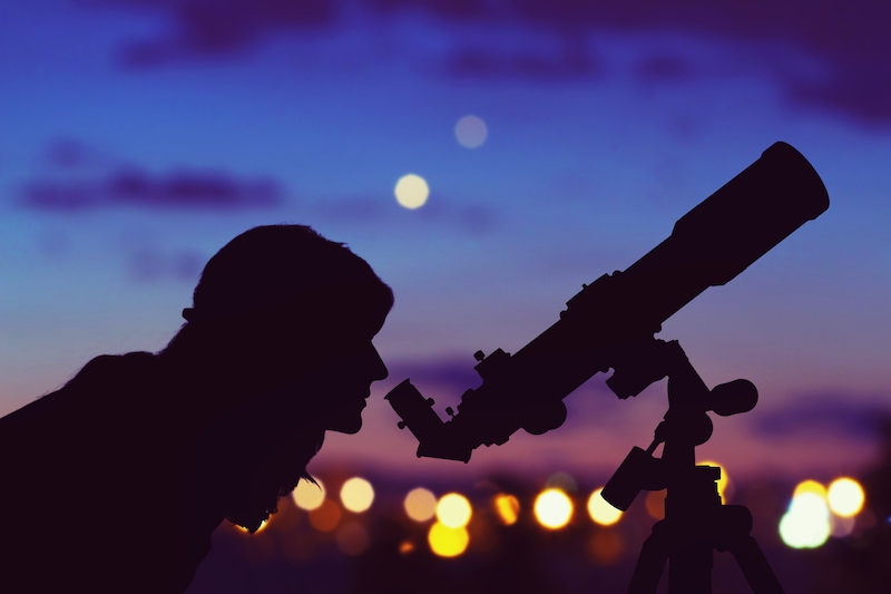 Person looking through telescope_AstroStar