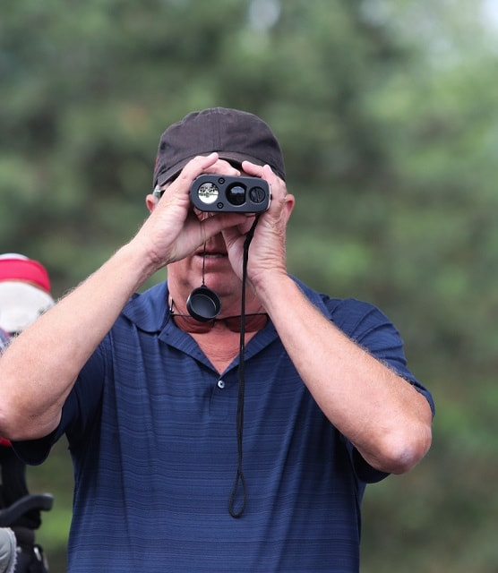 golfer uses a measuring device_Ron Alvey_shutterstock