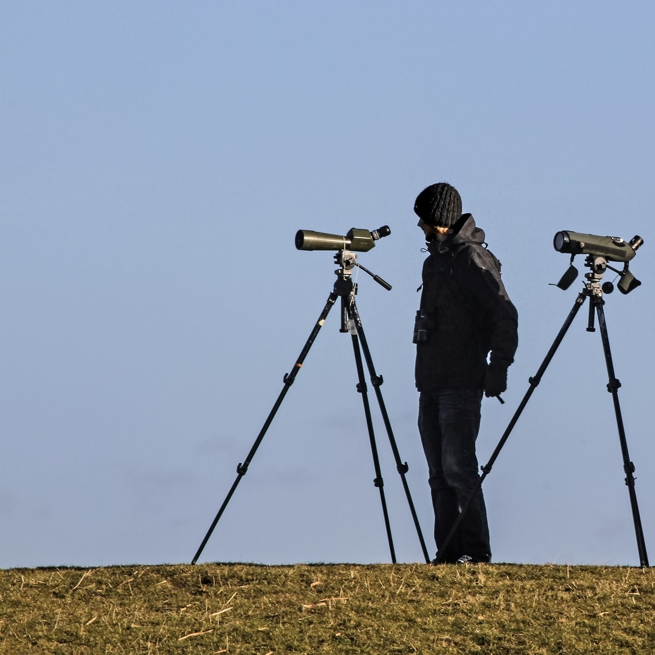 man with spotting scopes
