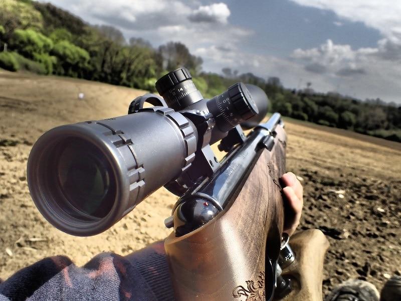 a close up of a rifle scope