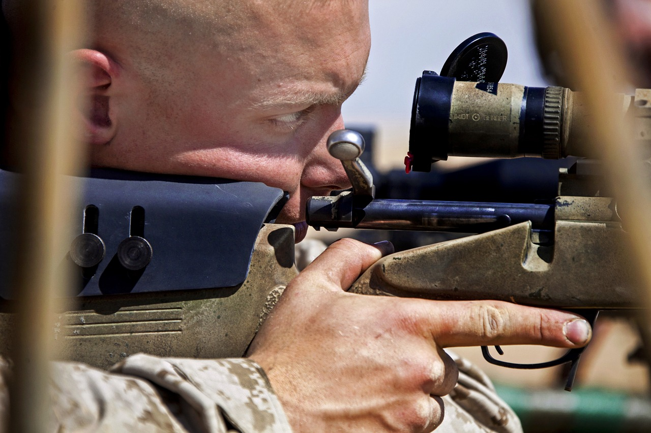 man looking at the riflescope