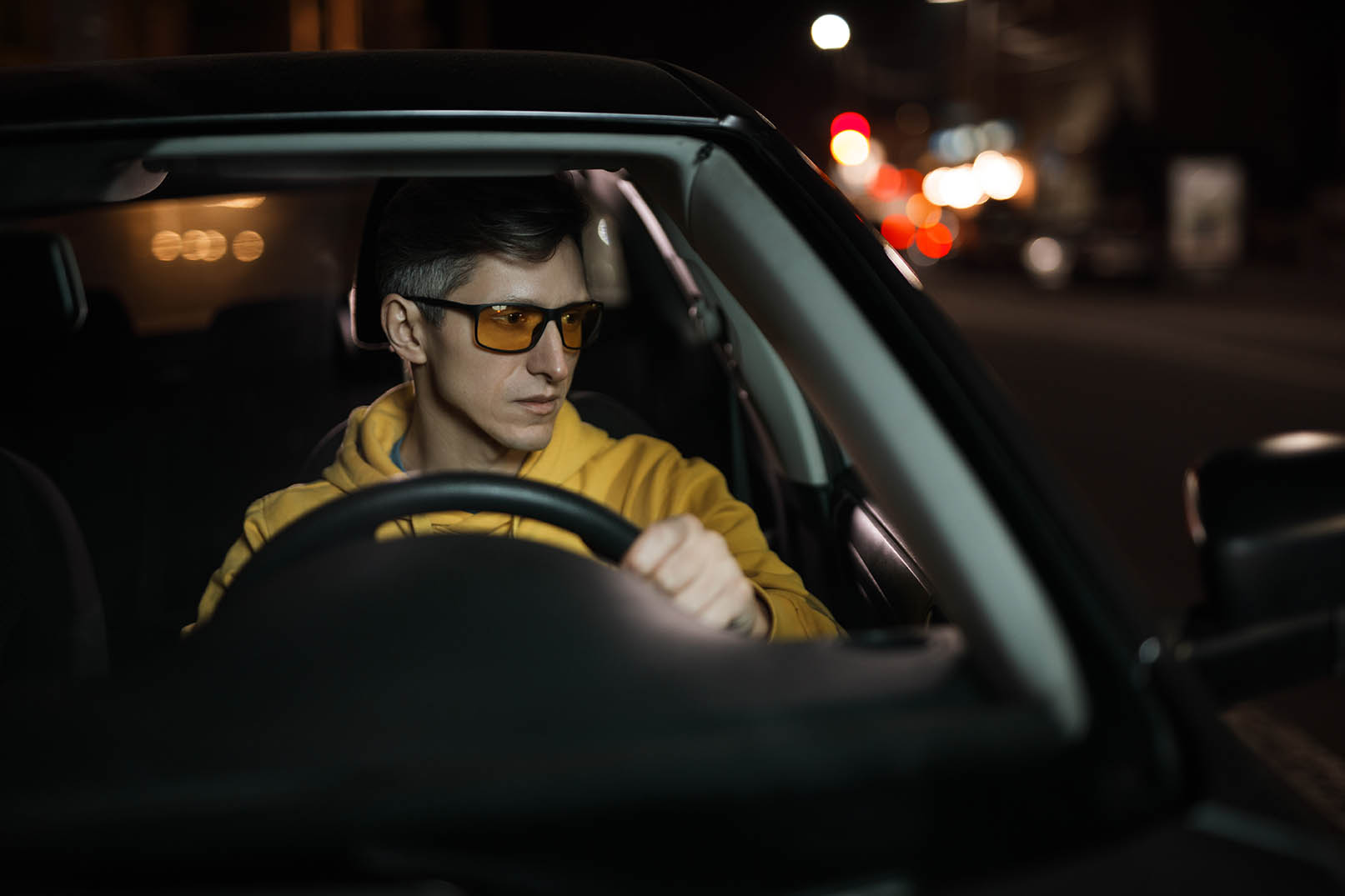 man wearing yellow night driving glasses