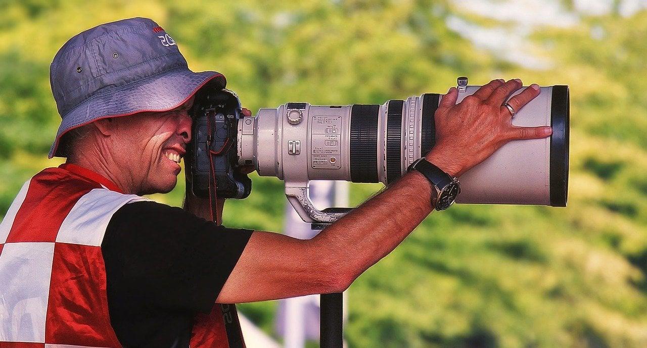 photographer using monopod